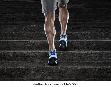Practice, close up of young man running up the stairs