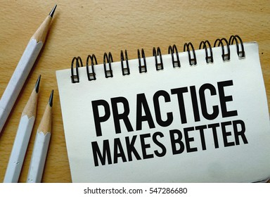 Practice Makes Better text written on a notebook with pencils