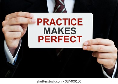 Practice Makes Perfect card in male hands