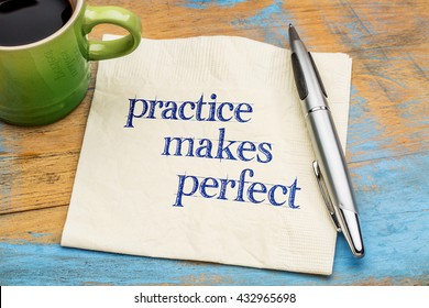practice makes perfect - handwriting on a napkin with a cup of coffee