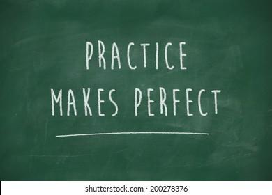 Practice makes perfect handwritten on school blackboard