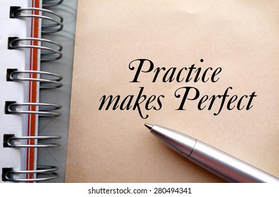 Practice makes perfect text write on paper as background with pen and book