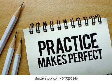 Practice Makes Perfect text written on a notebook with pencils