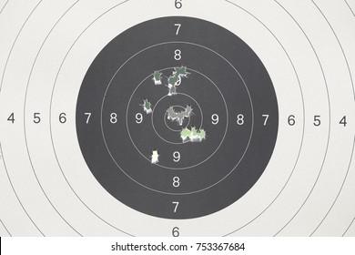practice shooting range target with bullet holes from gun shot