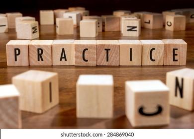 PRACTICE word written on wood block