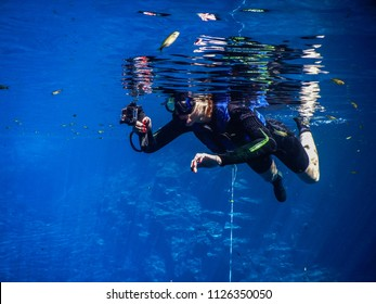 Practicing diving and snorkeling, mysterious lagoon, beautiful lagoon of transparent turquoise blue water, located in the city of Bonito, Mato Grosso do Sul, Brazil