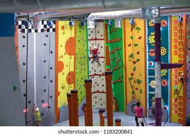 practicing rock climbing on artificial wall indoors