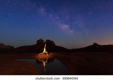 Practicing Yoga at Cathedral Rock Under the Milky Way