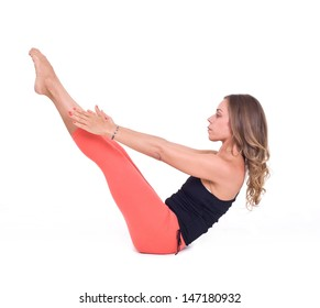 Practicing Yoga exercises. Young  woman doing  Yoga exercises in studio on white background.  Pose name: Boat Pose - Navasana