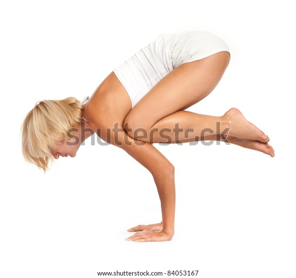 Practicing Yoga. Young woman isolated on white background