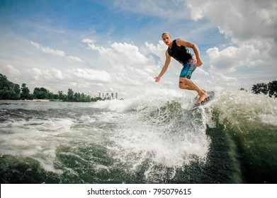 Practised athletic rider moves outside of the wake and cuts rapidly in toward the wake