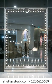 Prada shop at Emquatier, Bangkok, Thailand, Dec 25, 2018 : New collection of luxury and fashionable men casual clothing, shoe and bag showcase at flagship store.