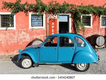 Pradamano, Italy. July 16,2019.   Classic blue Citroen 2Cv Special  parked outside a farmhouse after vintage car exhibition in summertime