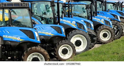 Pradamano, Italy. March 9, 2021.  New Holland tractors in a row outside the local dealership of the american company.