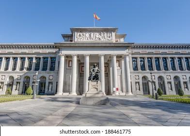 Prado Museum facade and Cervantes statue in Madrid, Spain