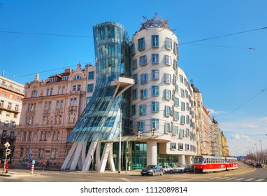PRAGUE - APRIL 10:  Nationale-Nederlanden building on April 10, 2018 in Prague, Czech Republic. This building has a nickname The Dancing House or Fred and Ginger.