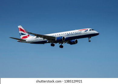 PRAGUE - APRIL 19, 2019: British Airways  Embraer ERJ 190 landing at Vaclav Havel airport Prague (PRG) APRIL 19, 2019 in Prague, Czech Republic.British Airways is the flag carrier airline of the UK.
