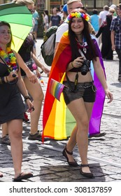PRAGUE - AUGUST 15, 2015: A girl wearing a large rainbow flag around her shoulders at the parade at the fifth Prague Pride 2015 with up to 35,000 people attending.