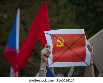 PRAGUE - AUGUST 18, 2018: Hundreds of people commemorate the 50th anniversary of the Warsaw Pact invasion of Czechoslovakia on the square in front of the Russian Embassy.