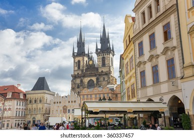 PRAGUE - AUGUST 4: people walk in old town hall or clock tower and The Tyn Church on  background on august 4,2015 in Prague - Czech