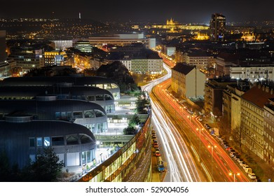 Prague from beauty bird perspective. Modern urban Prague part with old town in background. Cityscape to highway full of car lights