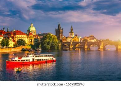 Prague Castle, Charles Bridge and boats on the Vltava river. View of Hradcany Prague Castle, Charles Bridge and a boats on the Vltava river in the capital of the Czechia. Boat cruise on Vltava river.
