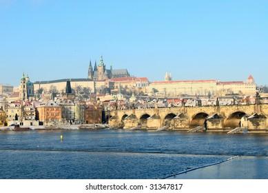 Prague castle and charles bridge in winter