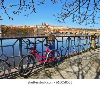 Prague Castle with famous Charles Bridgea and with pink bike in the foreground in Czech Republic