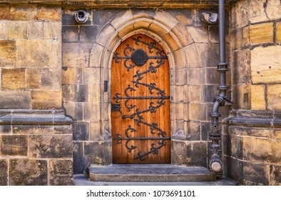 Prague Castle - Gothic architecture of st. Vitus cathedral back door. Czech Republic