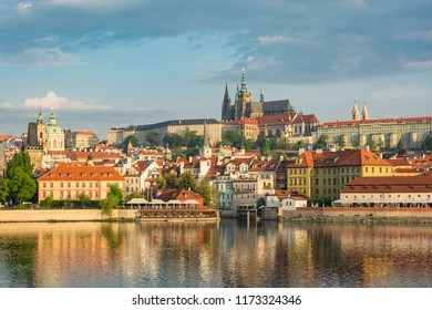 Prague castle, St. Vitus cathedral and Vltava river in morning view taken from Vltava riverside