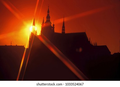 Prague castle - sunset behind the tower of St.Vitus cathedral