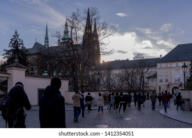 Prague Castle,Czech Republic-January-02,2018:Many people are walking go to Prague Castle and photograp achitecture building .