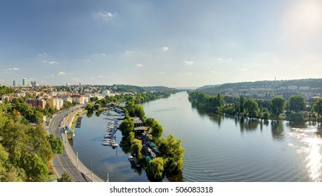 Prague cityscape panorama in an afternoon sun with Vltava river flowing through the city center, Czech republic. Photo taken at Vysehrad.