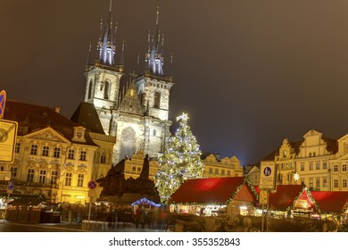 PRAGUE, CZ - DECEMBER 15, 2015: Traditional Christmas markets at Old towns square in Prague, Czech republic, with many visitors captured motion blured on the HDR image