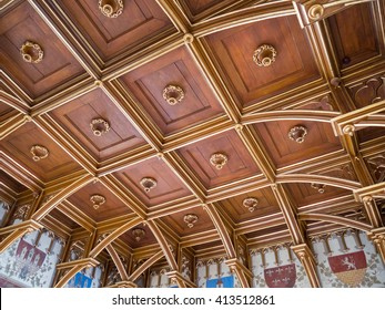 Prague, Czech - 1 Nov 2015: Wooden carved ceiling in the Old Town Charles bridge tower (Karluv most, Praha). Coats of arms and carving interior with medieval decoration.