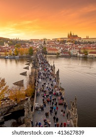 Prague, Czech - 1 NOV 2015: Crowd of tourists people walking Charles bridge (Karluv most) through Vltava river in the old town of the Prague (Praha) Czech Republic.