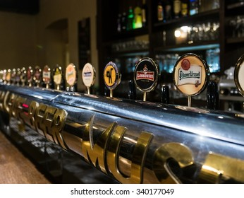 prague, czech - circa november 2015 - a variety of beer taps in a pub in prague - selective focus and slight grainy style
