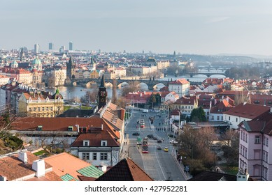 PRAGUE, CZECH - MARCH 14, 2016: Cityscape of Old Town with Palace and Vltava river. Tram in Background