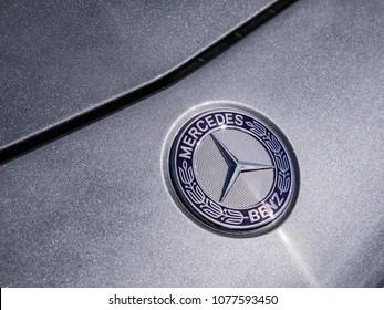 PRAGUE, CZECH REP - APRIL, 26 2018. 2017 Mercedes-AMG GT C Roadster parked at Terminal 3 Airport in Prague. Detail on Mercedes Benz logotyp