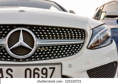 PRAGUE, THE CZECH REP., NOVEMBER 27, 2016: Closeup of front view Luxury car white cabrio Mercedes-Benz C200 with red roof. Car parking in front of car store Daimler