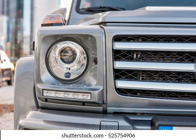 PRAGUE, THE CZECH REP., NOVEMBER 27, 2016: Closeup of new luxury car Mercedes-Benz G 350 d parking in front of car store. Detail of front view of car