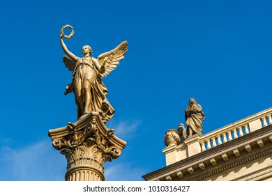 Prague, Czech Repoublic: Statue of an angel in front of the Rudolfinum concert hall.