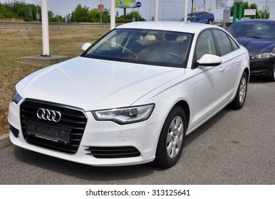 PRAGUE, THE CZECH REPUBLIC, 02.08.2015 - Brand new white Audi A6 parks in front of Car Store Audi