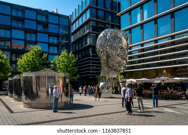 PRAGUE, CZECH REPUBLIC - 05 May, 2018: Rotating statue of Franz Kafka head in Prague, Czech Republic against blue sky.Modern statue of famous writer. Landmark is made of silver metal and steel.