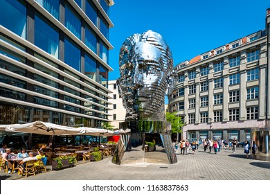 PRAGUE, CZECH REPUBLIC - 05 May, 2018: Rotating statue of Franz Kafka head in Prague, Czech Republic against blue sky.Modern statue of famous writer. Landmark is made of silver metal and steel