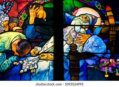 Prague, Czech Republic -  07 01 2017: Death of St. Methodius, detail of art nouveau stained glass window by Alfons Mucha, St. Vitus Cathedral, Prague castle