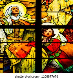 Prague / Czech Republic - 07 01 2017: Detail of art nouveau stained glass window by Alfons Mucha, St. Vitus Cathedral, Prague castle, St. Wenceslas with his grandmother St. Ludmila