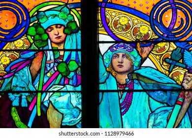 Prague / Czech Republic - 07 01 2017: Detail of art nouveau stained glass window by Alfons Mucha, St. Vitus Cathedral, Prague castle - women who symbolize Czech and Slovakian people