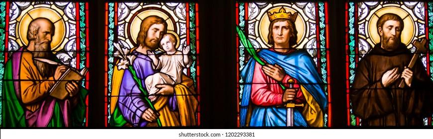 Prague / Czech Republic - 07 01 2017: Close-up of art nouveau stained glass window by Alfons Mucha, St. Vitus Cathedral - Saints Luke, Joseph, Sigismund and Guilelmus