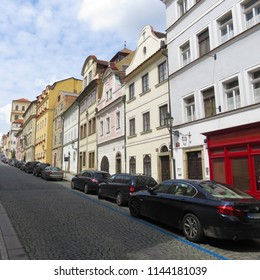 Prague / Czech Republic - 07 16 2017: a long row of parked cars along a rectilinear ascent to the hill, the district of Prague 1, the old town